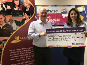 Steve Harris presents the cheque to Emma Jane Jones from Bloodwise.